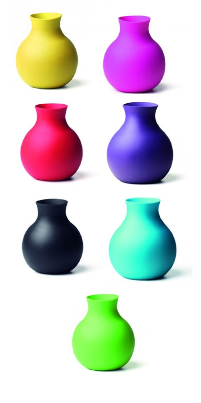 """Squishy and shatter-proof, the all- rubber, multitasking Menu vase folds down to accommodate shorter arrangements."""