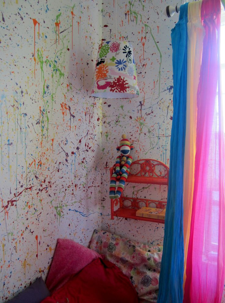 Splatter walls in my daughters room. Painted the walls white then let her go with paint and a brush... SPLATTERED! and very cool!