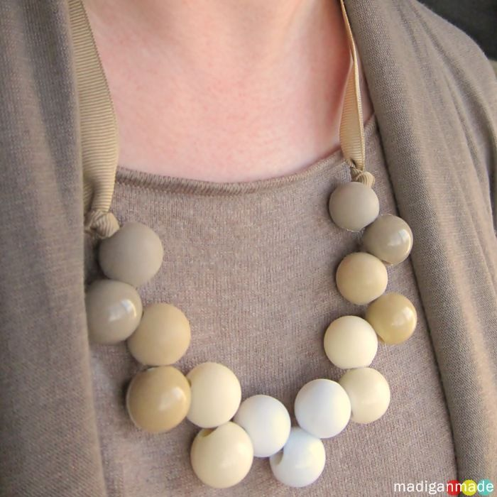 Tutorial for Dollar Store Pony Tail Holder necklace. She sands the beads to give them a matt finish. Great idea!!! Why have I been splurging on giant beads? I love this - how cute would it be to do little girl ones and spray paint them fun colors?