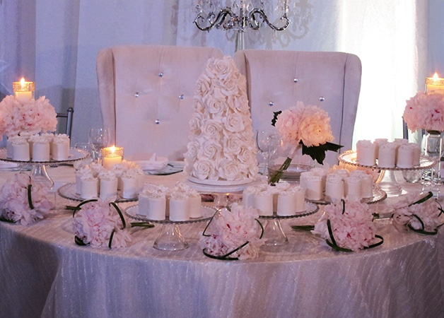 Romantic pink palette, table full of mini cakes on stands