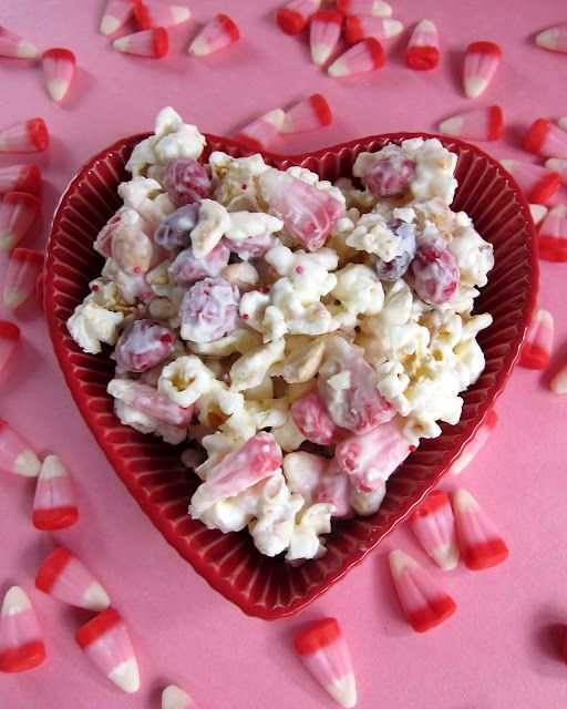 Cupid Crunch: 1 (24oz) pkg. vanilla Almond Bark, 2 bags microwave popcorn (popped, approximately 16 to 20 c.). 1 1/2 c. Valentine candy corn. 1 c. dry roasted peanuts. 1 1/2 c. M (Valentine colors). Pop popcorn place in LARGE. Add pnuts, candy corn and M). Mix bark and pour over popcorn mixture. Stir to mix well. Spread on waxed paper. Let sit until dry. Break up into clumps. Enjoy!!!