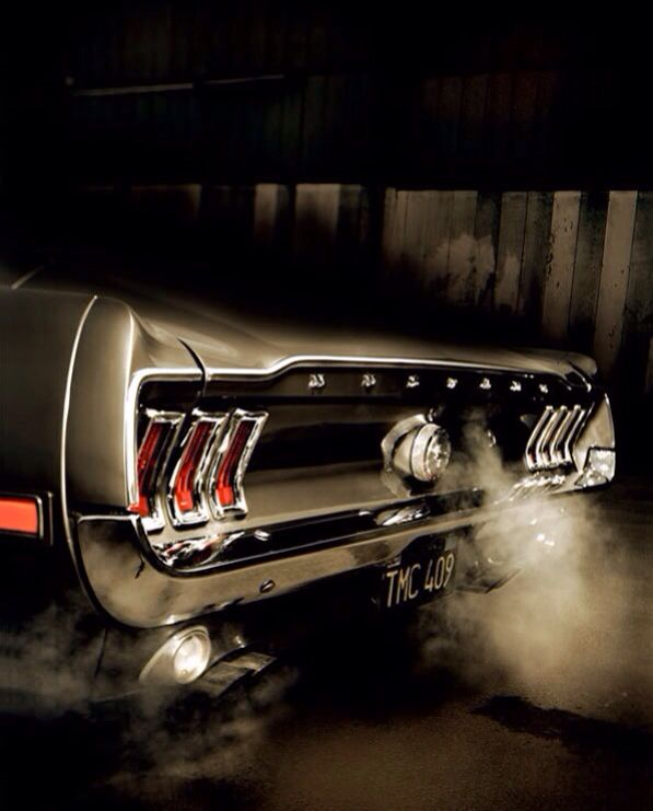 Classic Mustang...cool whisps of exhaust!