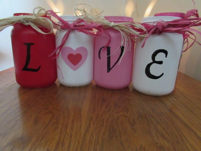 """~ """"Love"""" mason jars for valentines day with raffia as ribbon heart stickers for the O and stenciled letters with sharpie  ~ Diy ~ Valentine decor ~ Valentine crafts ~ Mason jar decor ~ mason jar crafts ~ stenciling ~ Country ~ rustic ~ shabby chic ~"""
