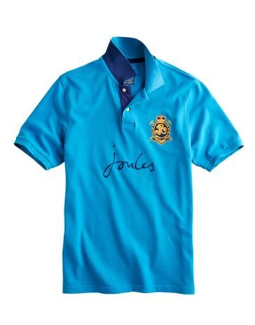Joules Mens Classic Fit Polo Shirt, Cobalt Blue.                     This truly classic Joules polo shirt has been built for whatever the weekend may bring. Crafted from sturdy cotton pique and finished with badging and embroidery detail that harks back to our heritage. The contrast colour under the collar is a classic touch, too.