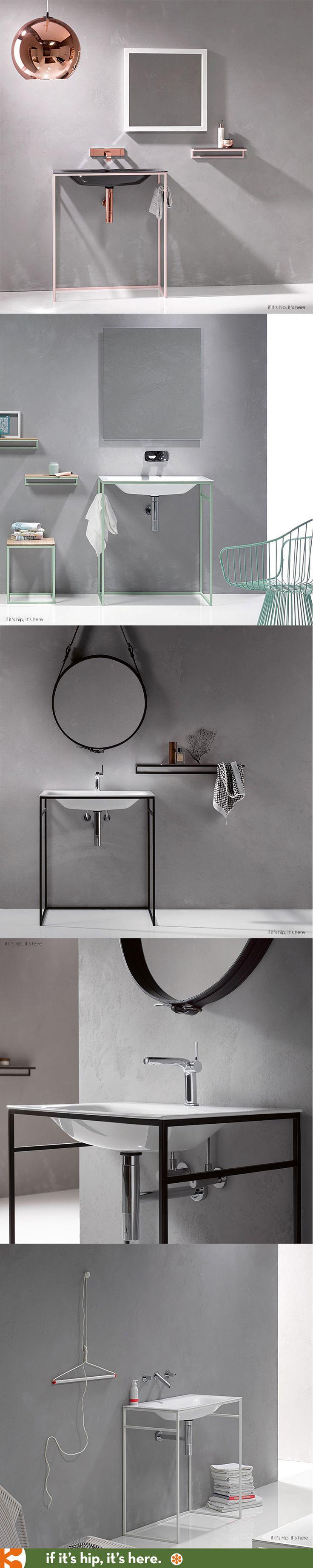 Bettelux enamel washbasins in colored steel cubic frames.