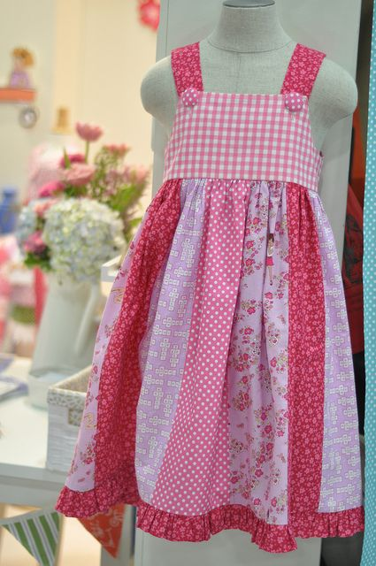 So cute! children at play dress... I like the idea of using a jelly roll to create the bottom of a dress or to sew up a skirt.