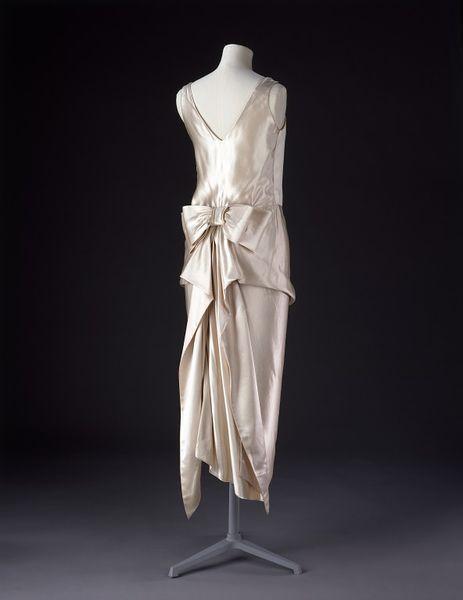A stunning, hand-sewn, satin evening dress.