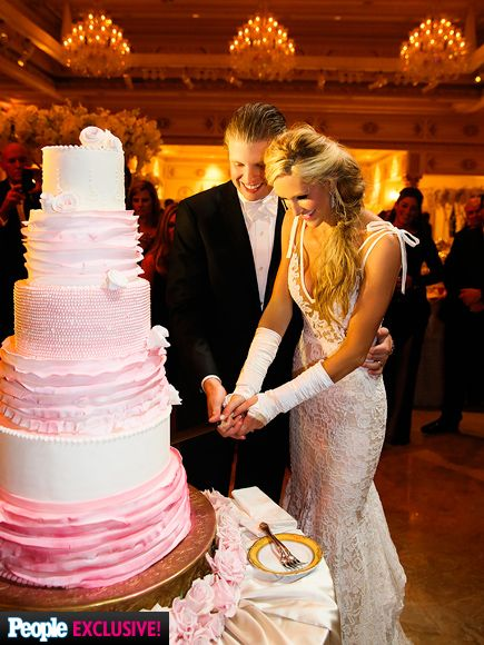 Donald Trump's son Eric and his bride Lara Yunaska on November 8, 2014. She is wearing a Inbal Dror by Mark Ingram Atelier gown for her reception (her gloves hide casts she wore because of broken wrists).