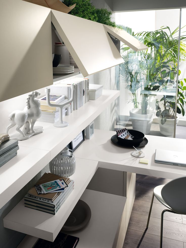A large living area offering a relaxation zone that also includes a desktop for study | #Design and #Comfort by #Scavolini |