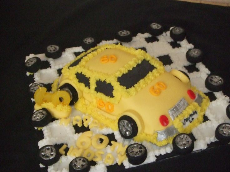 This car was done for a man's 60th birthday whom loves everything yellow. The whole cake board was done in black & white squares and handmade tyres around the outside of the board  The car was     covered in Renshaws   yellow fondant and decorated accordly. Cakes For All Occasions Mosgiel Otago New Zealand  website: www.icedcakes.co.nz
