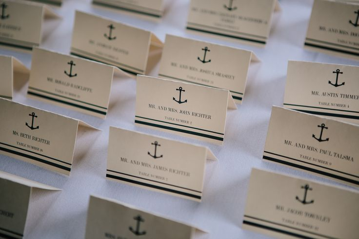 Nautical escort cards for a shipyard wedding  #brideside #realwedding #wedding #nautical #preppy #anchor #beach #details #paper   Dreamy nautical wedding at a shipyard with creative details | Brideside