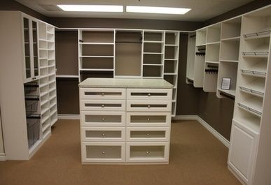 closet storage island | Walk-In Closet System With Island And A Variety Of Storage Spaces ...