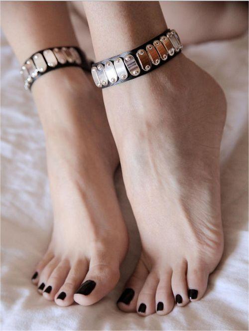 Not sexy girls with black toenail polish
