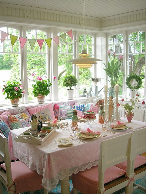 What a delightful enclosed-porch dining room. flickr.com