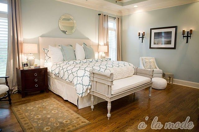 love that wall color and bench on the end of the bed