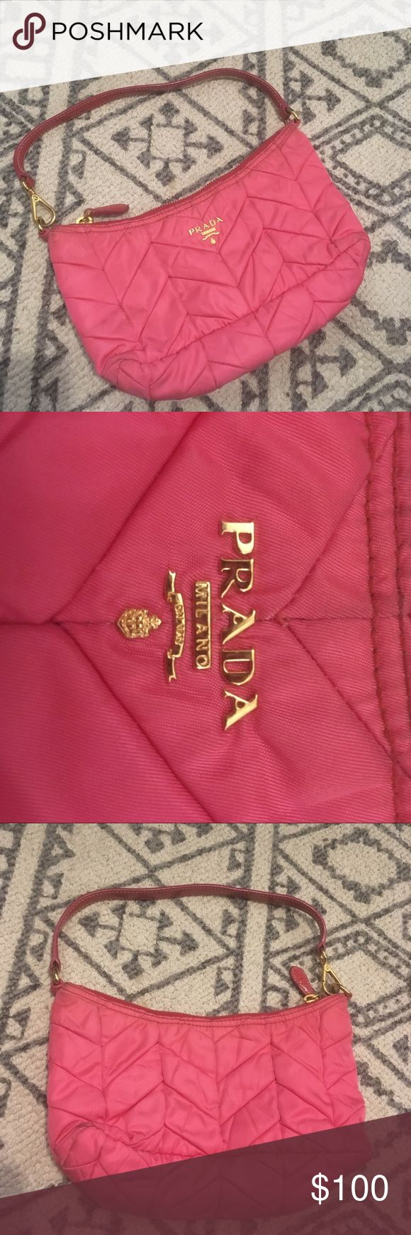 Pink nylon quilted Prada purse Pink nylon quilted Prada purse with gold zipper. Guaranteed authentic. Minor surface wear but overall good condition. 9 inches length , 5 inches width Prada Bags Mini Bags
