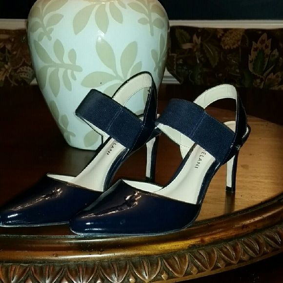 Antonio Melani Navy Patent Shoes Antonio Melani Navy Patent Heels w/Elastic Straps.  Only worn twice.  Good condition.  Small scuff on right front near toe box shown in pic.  Size 6 1/2 medium.  Thought I could wear but I am really a wide width. ANTONIO MELANI Shoes Heels