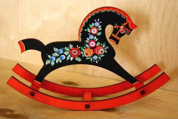 A wooden toy horse with folk Gorodets painting from Russia. #art #folk #painting #Russian