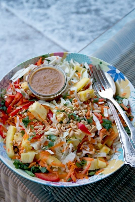 This Indonesian Pineapple Slaw with its Spicy Peanut Dressing does it for me. You can thank me later.. I can't hear you over the crunch..