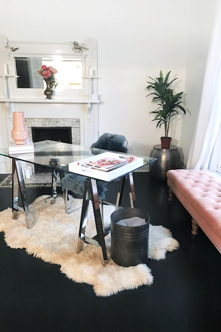 Feminine minimalist office decor | chic West Elm glass desk on a white fur  rug, Wayfair pink tufted bench, black wood floors and bright white walls |  Office ...