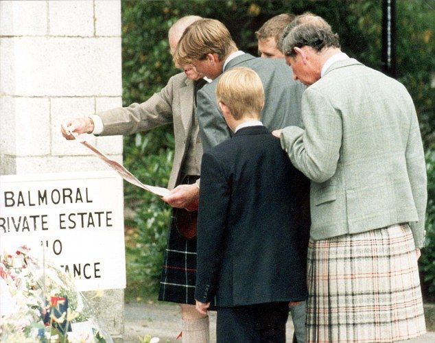 Royal family look at floral tributes and read messages of condolence outside Balmoral cast...