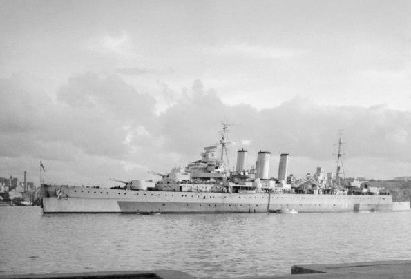 HMS Cumberland was a County class heavy cruiser of the British Royal Navy during WWII, shown here in Grand Harbor, Malta. year unknown (?)