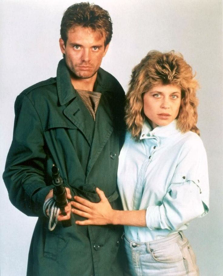 Michael Biehn as Kyle Reese and Linda Hamilton as Sarah Connor in THE TERMINATOR (1984).