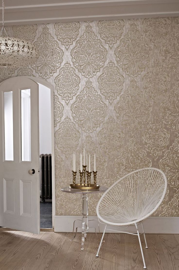 Gorgeous large scale damask wallpaper design on a soft gold metallic background.