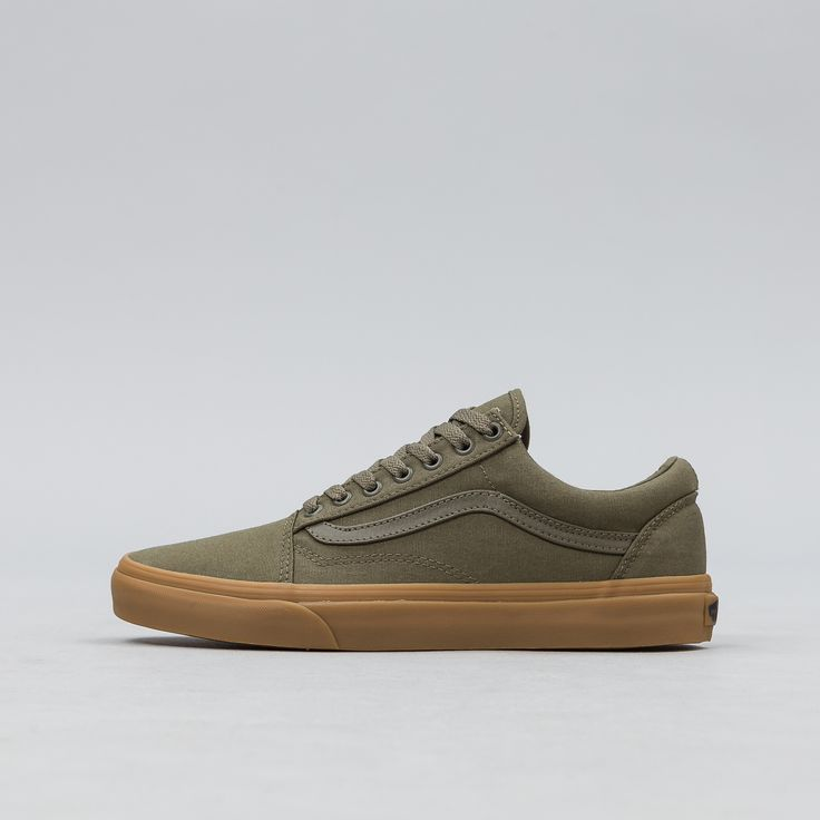 Classic low top lace-up skate shoe featuring sturdy canvas uppers, re-enforced toecaps, padded collars, and gum-colored signature rubber waffle outsoles. Ivy Green colorway. • Style #: VN0A31Z9L0G