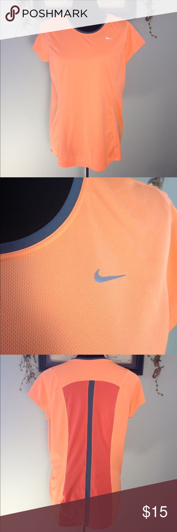 Nike Running Top Women's orange and gray Nike running shirt. There is a small snag as shown in the last picture. Nike Tops Tees - Short Sleeve