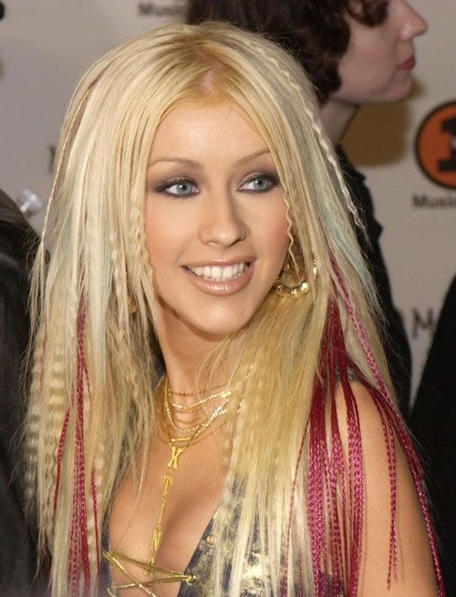 Remember when Xtina rocked crimped hair and colored extensions? Unfortunately, so do we. #tbt #hair #beauty