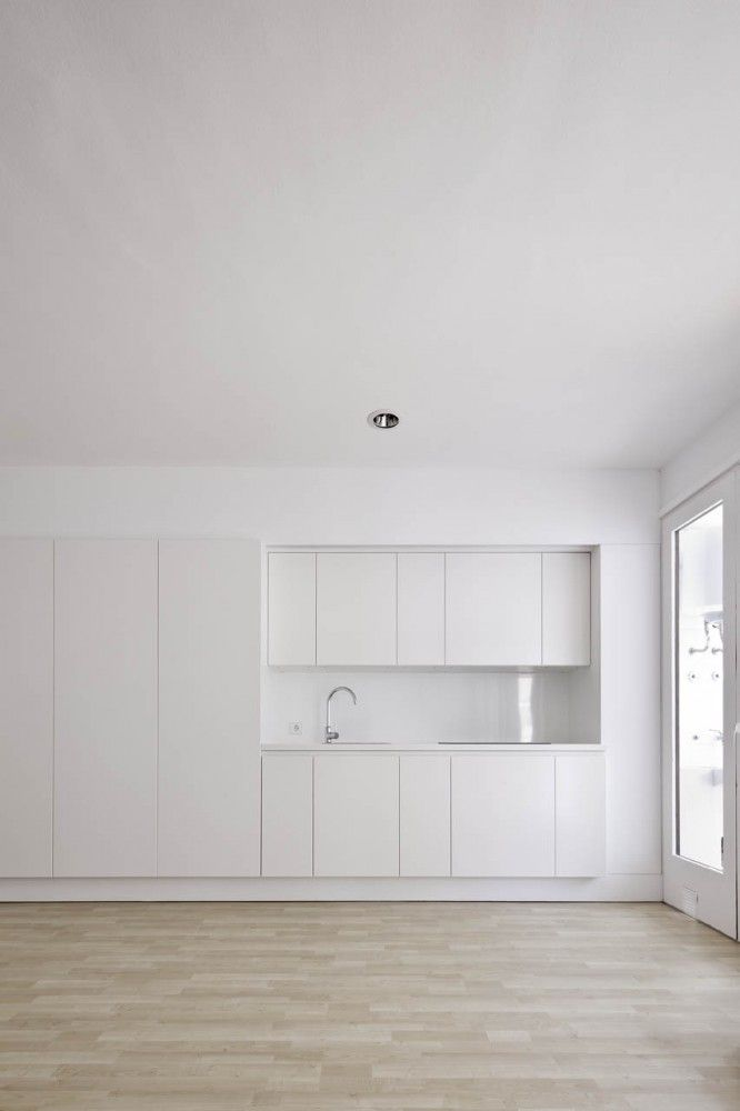 Kitchen minimalism. This great disappearing kitchen could be right in your living space in a tiny home, helping you to use space wisely: kitchen when you need it, living room when you need that.