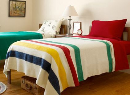 The Hudson's Bay Point Blanket might be the oldest and most identifiable Canadian tradition. These blankets were originally created in 1780 for fur trappers, traders and natives to survive outdoors in frigid Canadian winters. The point system is in place to rate the warmth and size of the blanket. These blankets are such high quality and so highly valued that they are often handed down through families and found for hundreds of dollars in thrift stores.