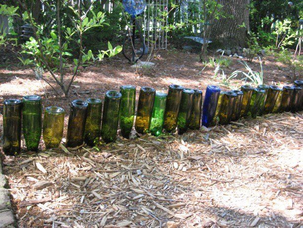 Flip bottles and plant them along your garden-would look better if placed so sunlight goes through