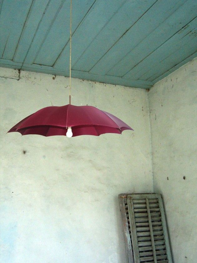 Picture this light fixture made out of an old umbrella hanging on your front porch!