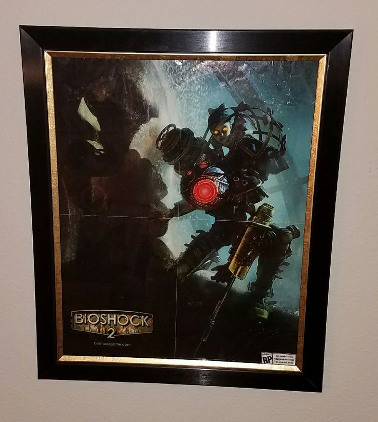 Got a custom frame for my Game Informer Bioshock 2 poster! (Xpost r/Bioshock)
