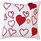 """Add a romantic touch to your decor with the """"Little Hearts"""" cushion cover. It is hand crafted with rich Indian Zari art. This cushion cover is ideal for both the bedroom and living room. In fact, it makes a lovely gift for friends as well."""