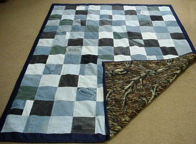 """I cut 6 1/2"""" squares from different areas of the pants. I sewed the blocks together with 1/4"""" seam allowance. The backing is camouflage polar fleece.   This quilt is the width of the fleece. I then machine quilted 1/4"""" on each side of the seam. The border and binding is from bought denim. This quilt is a twin size,"""