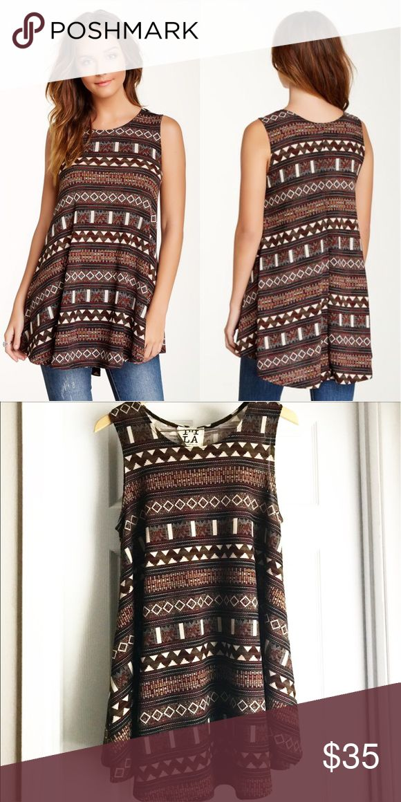 PPLA Aztec Tunic Tank/Dress This gorgeous tribal print tunic top is so perfect for any season or occasion! Wear it in the warmer months or layer it up when it's chilly! Amazing brown tribal print that goes with so much - a great staple piece! In like new condition! Great with leggings too! This is a very versatile juniors size large! PPLA Tops Tunics
