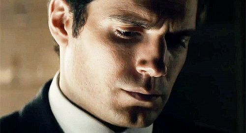 Pin for Later: 47 Sexy Movie Moments That Gave You Hot Flashes This Year The Man From U.N.C.L.E. Henry Cavill's sexy squint is enough to turn our legs to jelly.