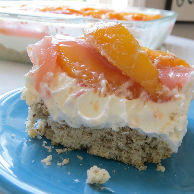 This peach delight recipe is a crowd pleasing favorite. Made in a 9 x 13 baking dish, it's layered with fresh peaches, whipped topping, and cream cheese.