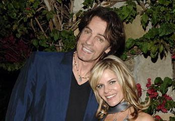 "Rick Springfield and his wife Barbara. Married since 1984, back when he was singing "" Jessie's Girl"" and appearing on ""General Hospital"" as Dr. Noah Drake. Major crush for me way back when!"