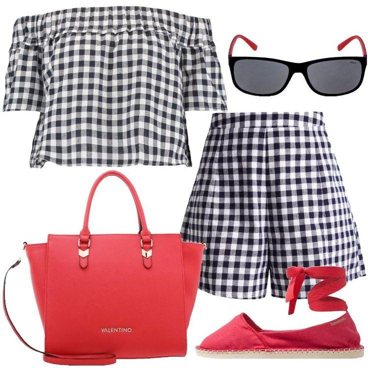 L'outfit è composto da una camicetta che lascia le spalle scoperte, un paio di pantaloncini a vita alta, un paio di scarpe rosse e da una borsa a mano rossa.