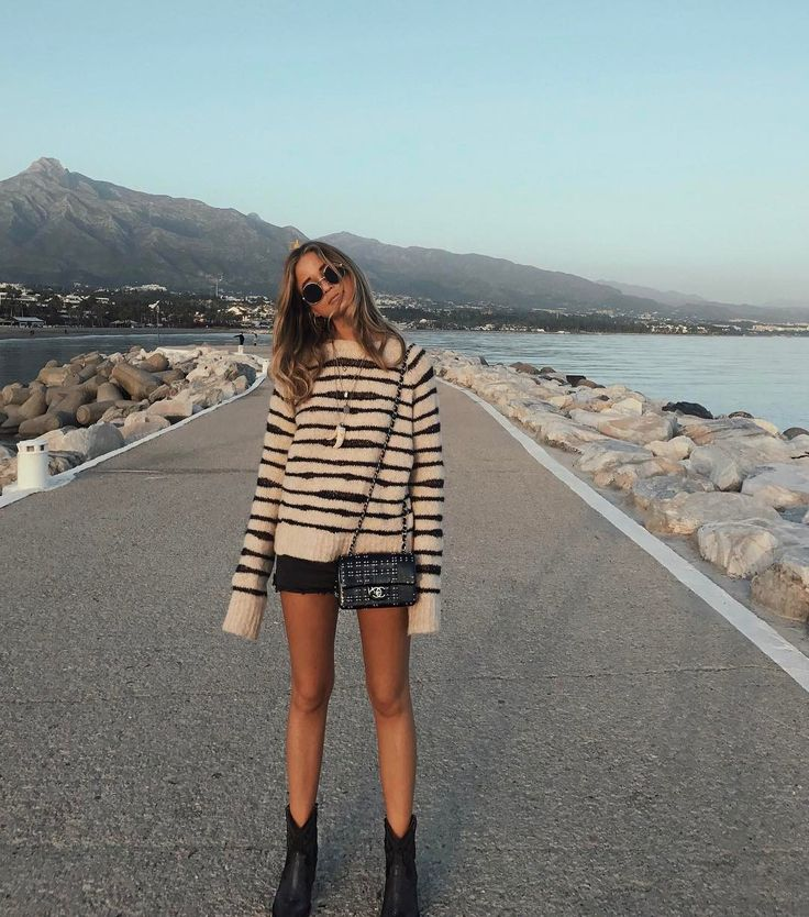 desert boho vibes in a striped sweater and cutoffs