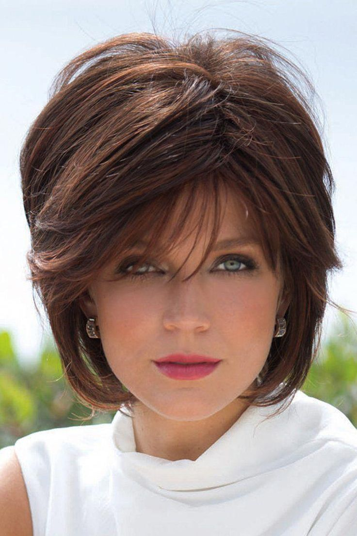 """Sassy tousled layered bob wig with fringe.Length: Fringe 5"""", Crown 6"""", Nape 4"""" Weight: 2.8 Cap Size: AverageColor Shown: Red Pepper  Wig Colors: Cap..."""