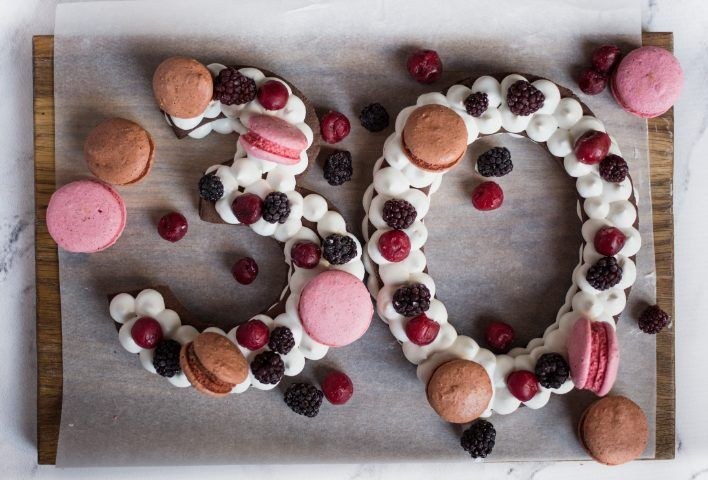 Ingredients:  For the cake:  3 cups flour;4 egg yolks;1 ¼ cup cold butter, cut into cubes;½ cup cocoa powder;2 cup powdered sugar.For the decorations:  macarons, berries of choice.For the cream:  ½ c