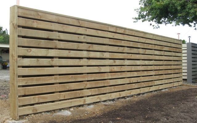 2.4m high fence out of rough sawn treated pine. Timber alternated on both sides with a capping on top and ends.