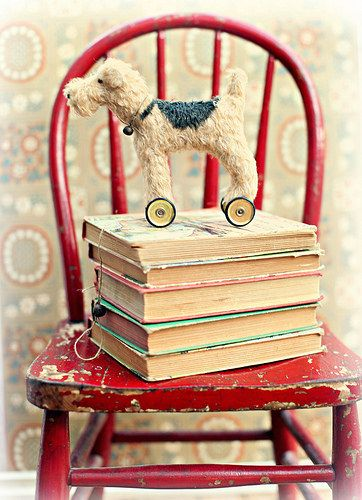 Cute old books and love that red chair!  I need to paint my little chair back to deep red.                                                                                                                                                                                 More