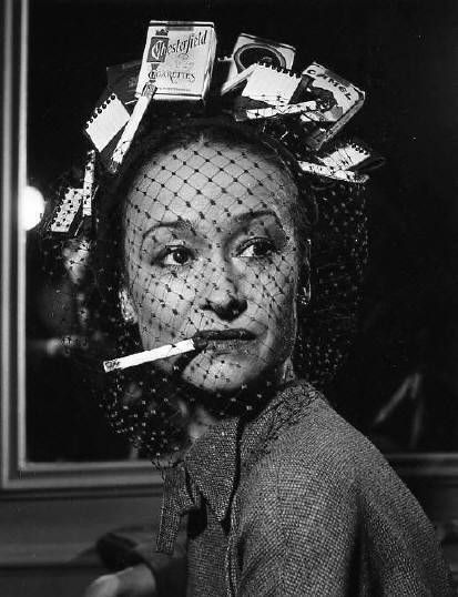 (cigarette hat), 1950, Chicago. Bob Natkin. Isn't she a cutie with her bad breath too!!
