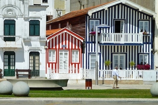 This may be something that works best in a sunny beach town, but the famous stripes of Costa Nova, Portugal are such fun color inspiration.    The houses were originally fisherman's shacks, painted to stand out against the sand. Over the years, they've gradually become vacation homes, and the latticing on many of them has been redone. The stripes, meanwhile, have become a colorful, beloved symbol of the town. Costa Nova, near Aveiro, Centro de Portugal Region, Portugal